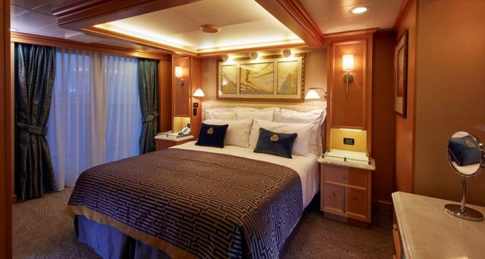 One of the stately rooms - a Grand Suite - onboard Queen Elizabeth. On this ship, expect formal nights and nightly dancing to the orchestra in the Queen's Room