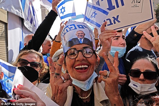Pictured: Supporters of Prime Minister Benjamin Netanyahu gather outside the district court in Jerusalem on April 5, 2021.Netanyahu is charged with accepting bribes, fraud and breach of trust in three cases