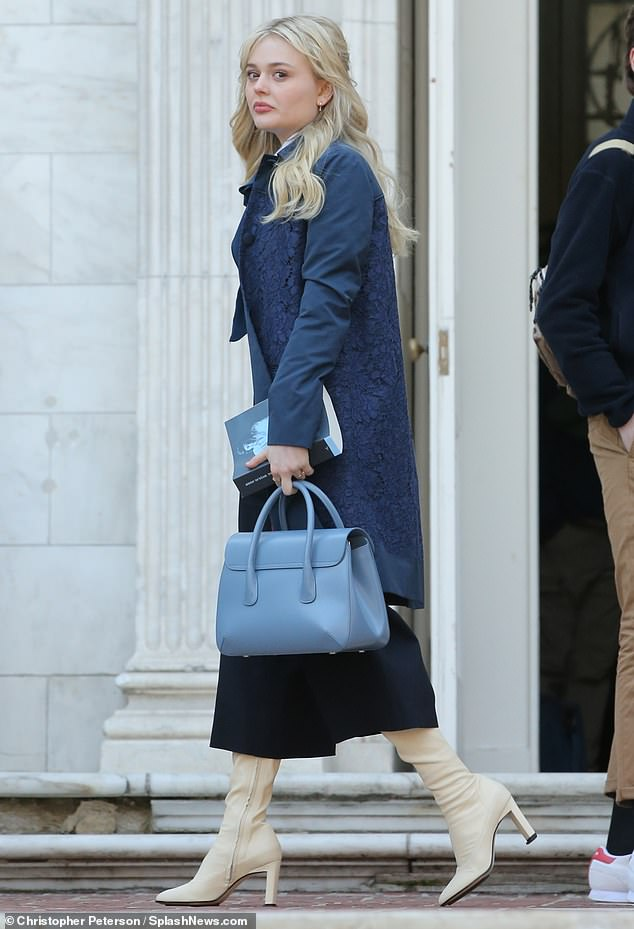 She's got the blues:Elsewhere on set was Emily Lind, who looked elegant in a lace coat with a powder blue bag and cream-colored boots with heels