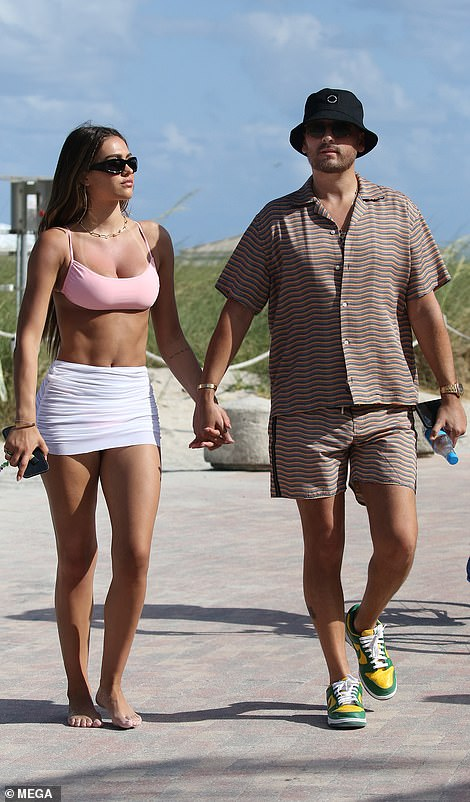 White hot: The 19-year-old daughter of Lisa Rinna and Harry Hamlin looked stunning in a tiny white mini-skirt and bikini top as she strutted alongside her much-older man in Miami over the weekend