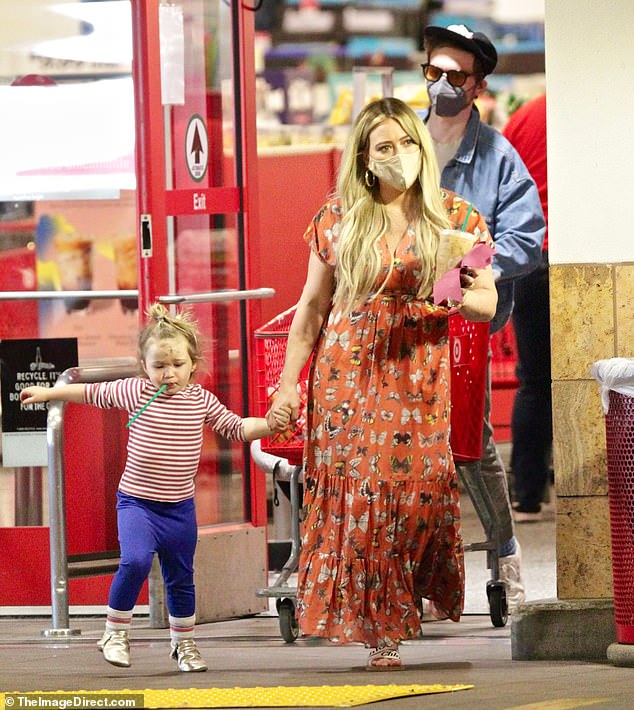 One stylish mama: The actress was a vision of summertime fashion with her butterfly print dress and Chloe sandals