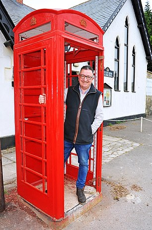 Shock tactics: Swindon Borough Councillor Gary Sumner with the soon-to-be defibrillator
