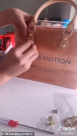 How to: After cutting off the cloth handles, the Louis Vuitton shopping bag is wrapped in a PVC case and a handle is fastened to each side