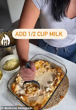 She then continues to mash after adding half a cup of milk