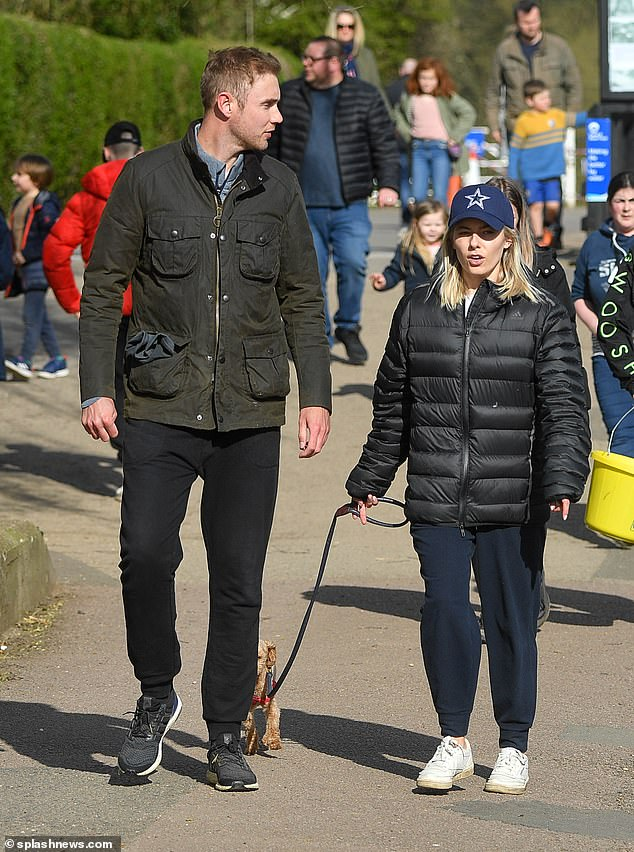 Smitten:The former Saturdays singer, 33,looked typically stylish as she nailed the casual-cool look in a black Adidas padded jacket while both of them sported joggers