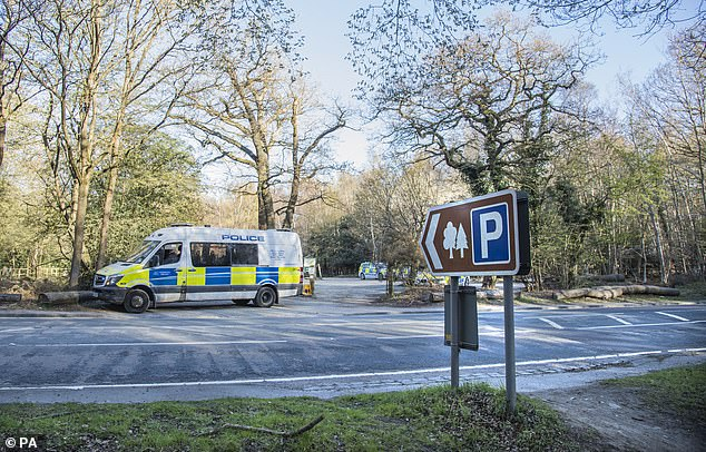 Metropolitan Police officers at the scene at the Wake Valley pond car park in Epping Forest. April 6