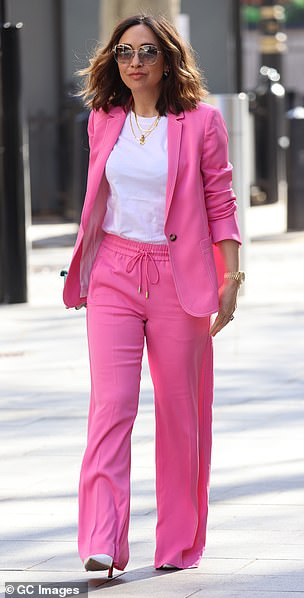 Hot pink: Myleene looked incredible in the colourful suit as she headed to work on Tuesday
