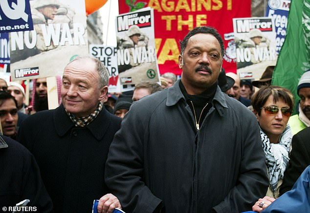 Rev Jackson is one of the most influential civil rights campaigners of his generation, having been close with Martin Luther King. Pictured: Rev Jackson walks with then Mayor of London Ken Livingston during an anti-war march in London in 2003