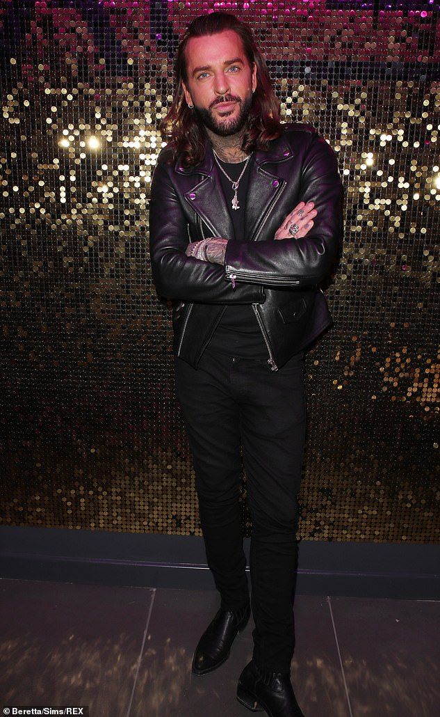 Lion's mane:His iconic long locks were swept back as he rocked a trim beard and pointed shoes