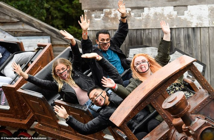 People wear face masks while riding the Scorpion Express at Chessington World of Adventures, which will reopen next week