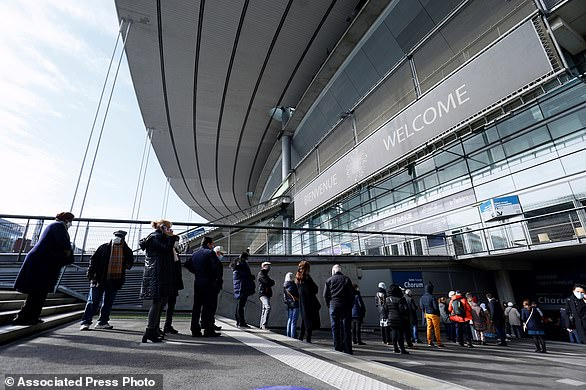 People arrive at the Stade de France stadium to be vaccinated against Covid-19 in Saint-Denis, outside Paris, Tuesday