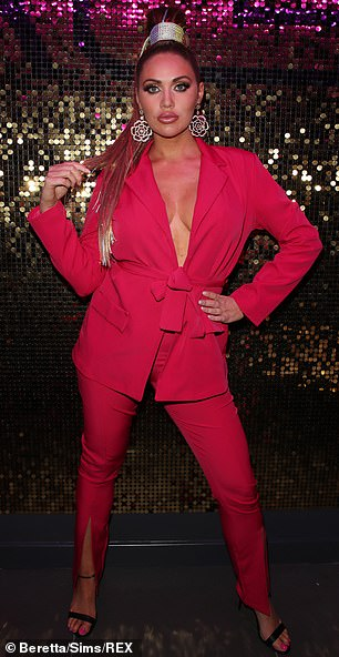 Pop of colour:Meanwhile Amy Childs put on an eye-popping display in a plunging red blazer and complementing trousers