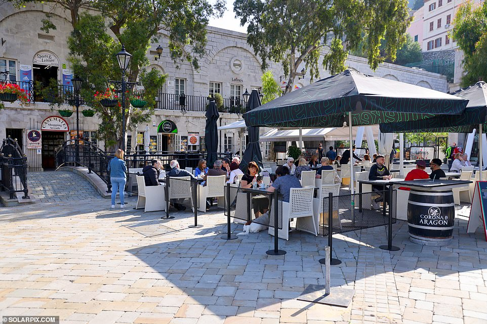 The PM yesterday confirmed plans to replace the foreign holidays ban with a 'traffic light' system which would open up quarantine-free travel to destinations rated green. Pictured: Outdoor dining in Gibraltar
