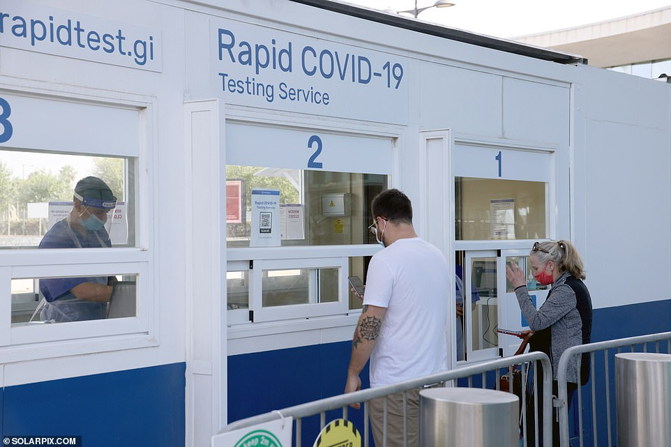 People flying into Gibraltar from Britain need to show proof of a PCR test or an online booking for a lateral flow test at a Portakabin outside the arrivals terminal (pictured) - and have to take another test if they are still on the Rock five days later