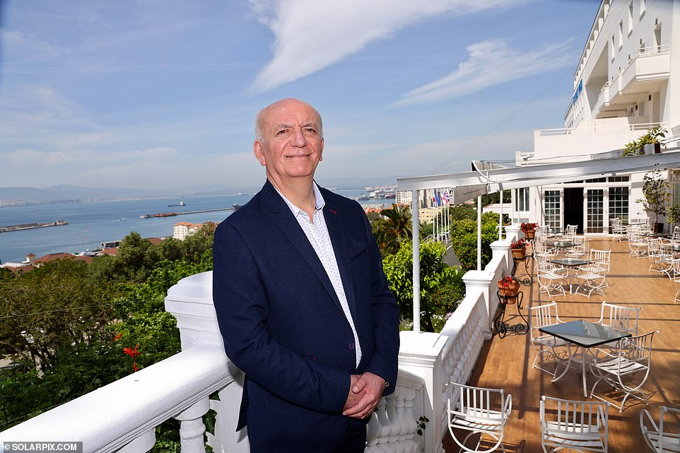 Charles Danino, 59, (pictured) manager of the iconic four-star Rock Hotel boasting magnificent views across the Bay of Gibraltar, the Spanish mainland and Morocco's Rif mountains, added: 'Gibraltar hasn't just taken care of its citizens with its vaccination programme but also the people who live in Spain and work here and that's a commendable approach'