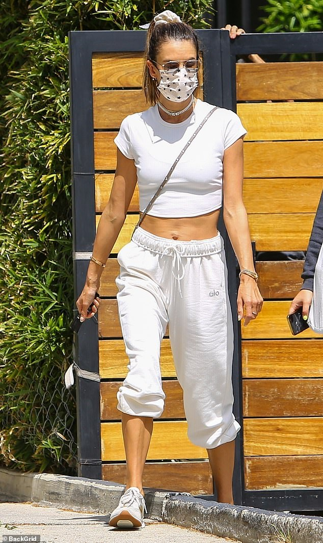 Sporty: The Brazilian beauty stepped out in an all-white ensemble from Alo Yoga, consisting of sweatpants and a crop top