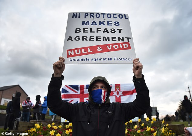 Loyalists hold up placards during an anti Northern Ireland Protocol protest against the so called Irish Sea border on Tuesday
