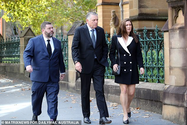 Mourners included Paul Murray and Ray Hadley who arrived with new wife Sophie Baird