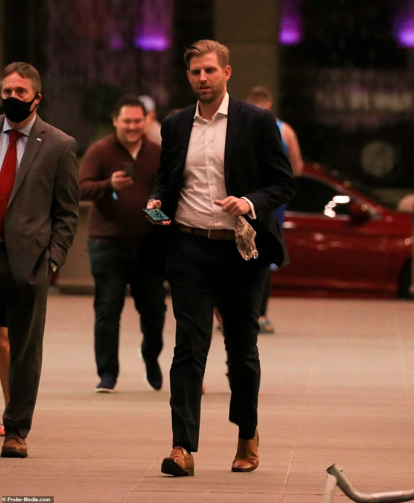 Eric Trump looks serious as he makes his way into Trump Tower having returned from south Florida