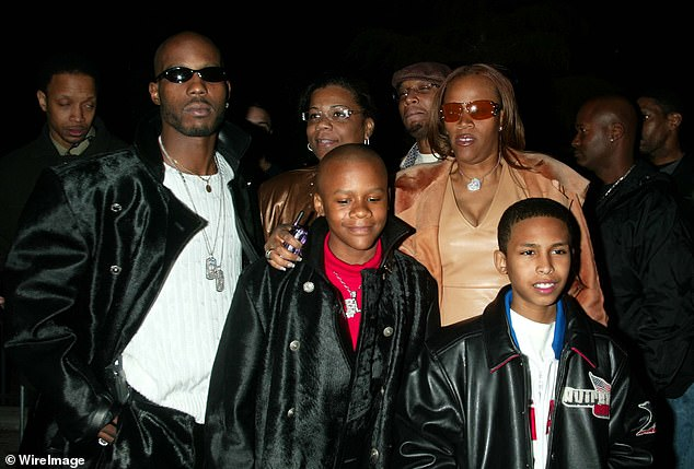 Beloved father:The rapper's condition remains critical and 'dire', according to TMZ, which prompted several of DMX's 15 children to head to White Plains to say their goodbyes (pictured with some of his children in 2004)