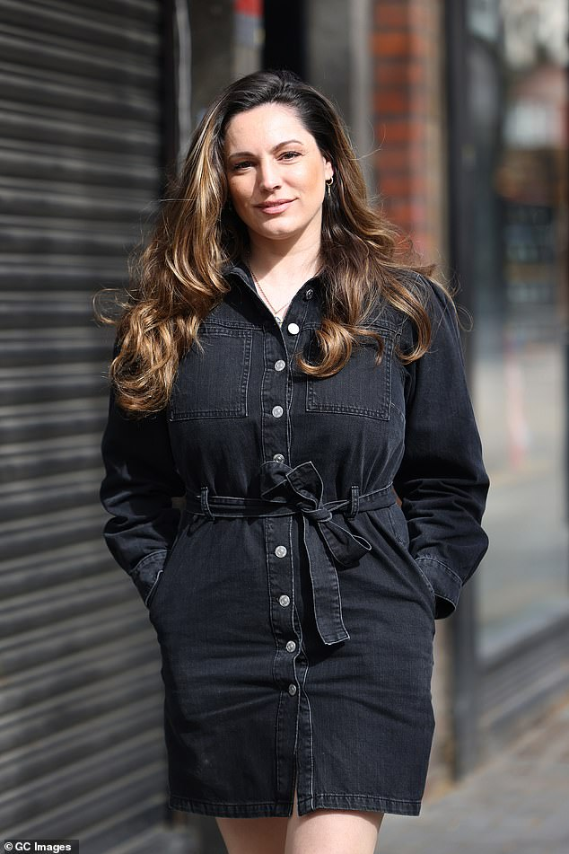 Lovely:The presenter, 41, put on a leggy display in a black denim dress which featured button detailing and a thigh-skimming hemline