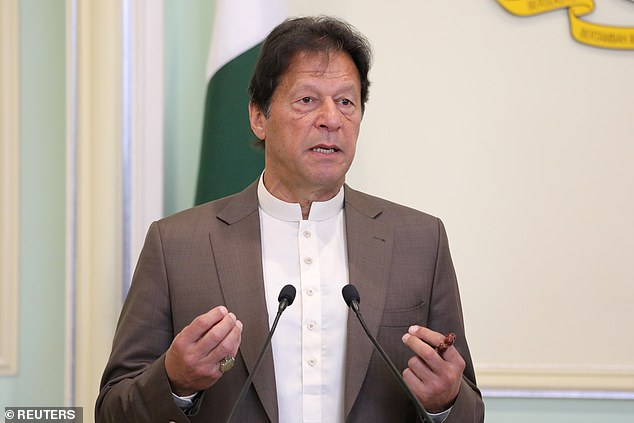 Pakistan's Prime Minister Imran Khan speaks during a news conference in Putrajaya, Malaysia, February 4, 2020