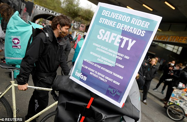 Deliveroo riders gather to demonstrate to push for improved working conditions, in London