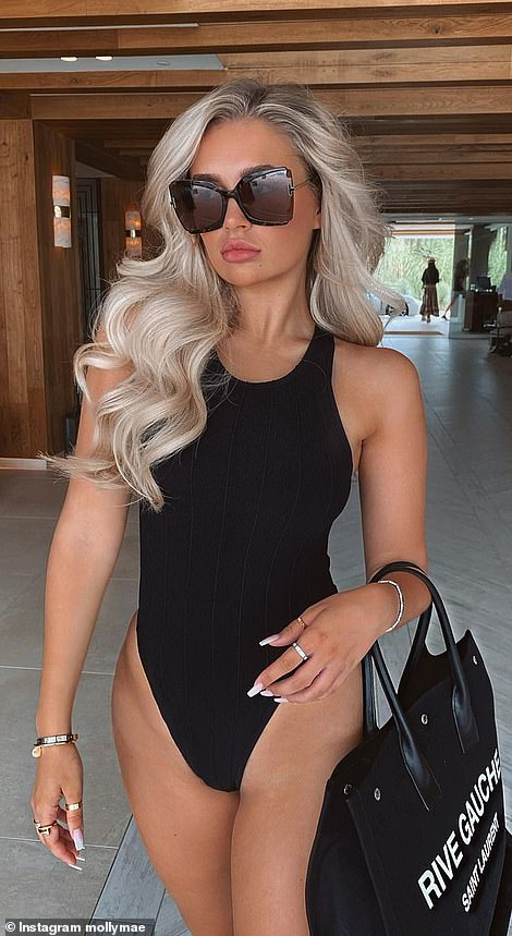 Molly Maelater shared a significantly more glamorous shot on her Instagram page, with her long locks styled into voluminous waves and her complexion looking more airbrushed