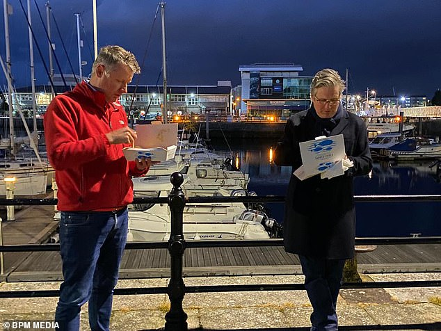Sir Keir Starmer today confirmed Labour will not back domestic vaccine passports as he labelled Boris Johnson's plans 'a complete mess'. He is pictured in Plymouth with Labour MP Luke Pollard