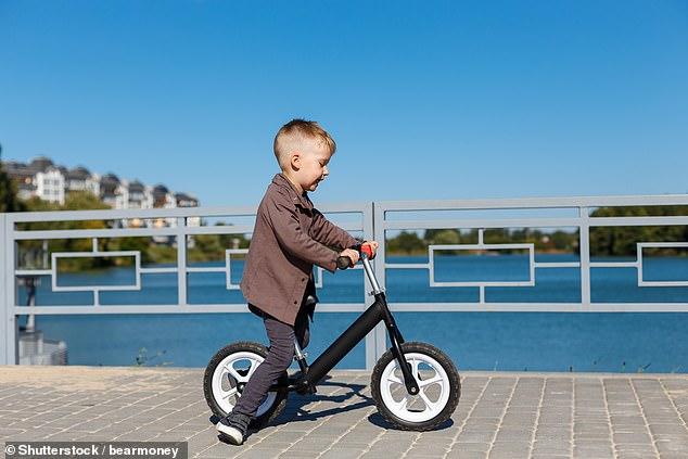 A small boy riding a pedal-less bike. Generations of people have learnt to ride a bike with the helpful addition of stabilisers - but could our learning to ride have been more pleasurable if designers had just taken away the pedals?