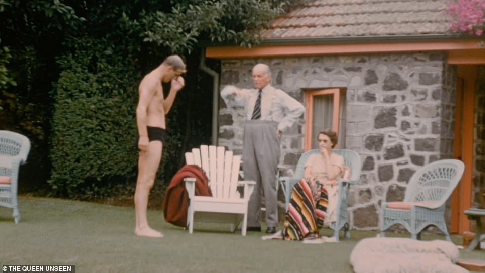 The Queen joins the family at the outdoor swimming pool, with the Duke of Edinburgh in swimming trunks and New Zealand's Governor General, Sir Willougby Norrie, standing alongside them on Christmas Day 1953
