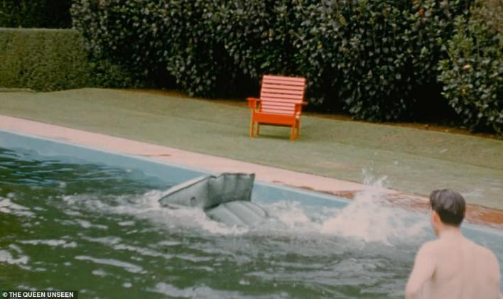 The Duke of Edinburgh splashes into the pool after falling from the lido. Taking a short break from the gruelling tour, the royal couple stayed with New Zealand's Governor General, Sir Willougby Norrie, whose wife filmed the visit which took place over Christmas in 1953