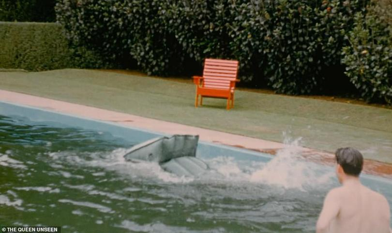 The Duke of Edinburgh splashes into the pool after falling from the lido.Taking a short break from the gruelling tour, the royal couple stayed with New Zealand's Governor General, Sir Willougby Norrie, whose wife filmed the visit which took place over Christmas in 1953