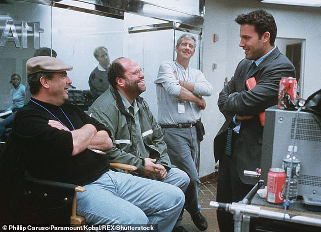 Rudin is pictured second from left on the set of the 2002 film Changing Lanes with Ben Affleck (right) and director Roger Michell (left)