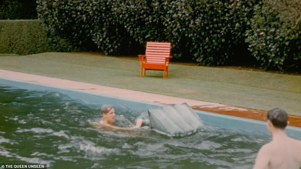 The Duke of Edinburgh falls into the water after struggling to climb onto a lilo in the pool in New Zealand on Christmas Day 1953. The rare and unseen private home movie forms part of a new documentary about the Queen on ITV at 9pm tonight