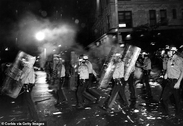 RIOT POLICE: Above, the NYPD carry shields to retake Avenue A during a riot outside Tompkins Square Park in Manhattan's East Village. The riot in 1988 began after police allegedly beat a homeless man; the area had been simmering for years as landlords abandoned building and the park, which is now rehabilitated, was the scene of drug-dealing and violent crime
