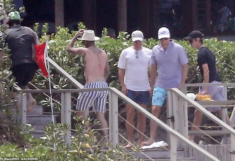 Home time: As other tourists made their way to the beach, the Beckham boys passed by