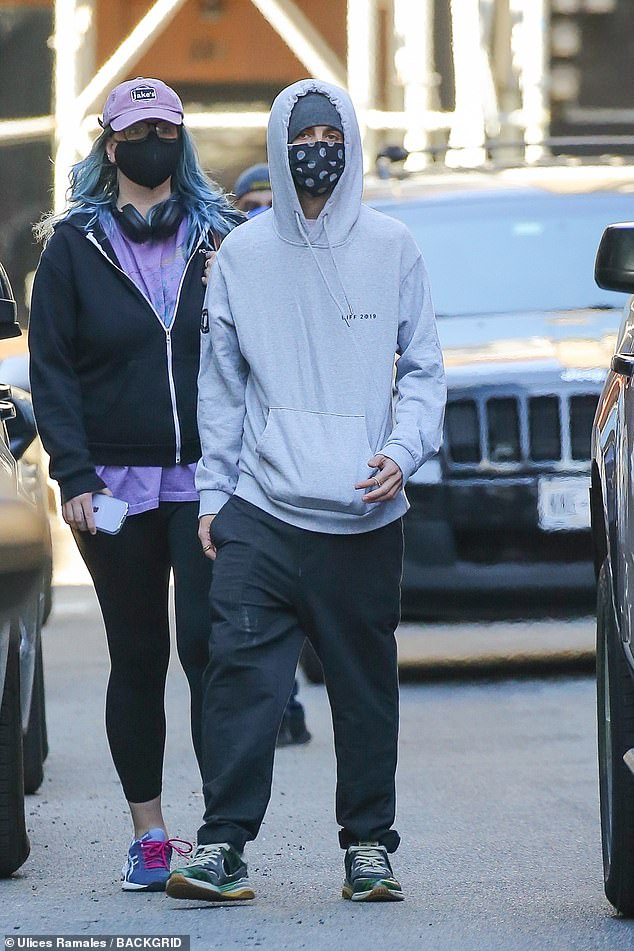Stepping out: Chalamet kept it casual and comfy with a light grey hoodie with the hood pulled up over a dark grey cap with a black face mask to stay safe from COVID-19