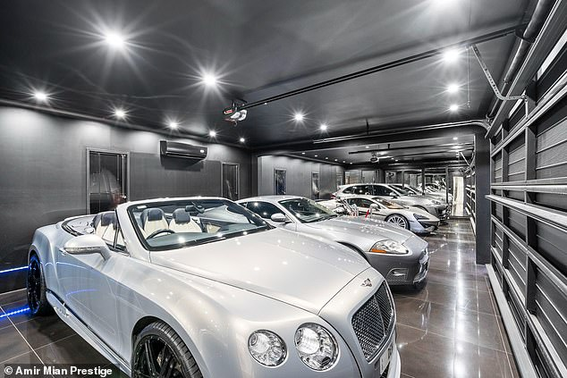The house has a five-seater garage filled with luxury cars which also serves as a `` nightclub ''