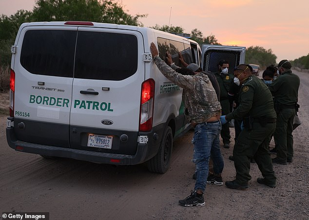 Border Patrol agents are seen arresting people in Penitas, Texas, on March 27