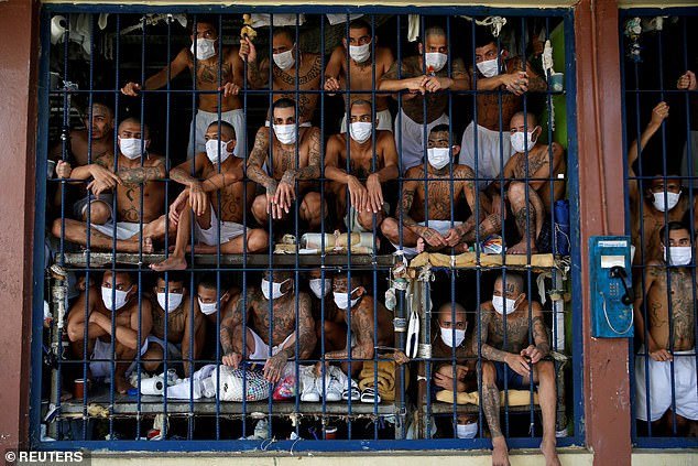 MS-13 began in LA in the 1980s and spread back to El Salvador. Prisoners are seen in September
