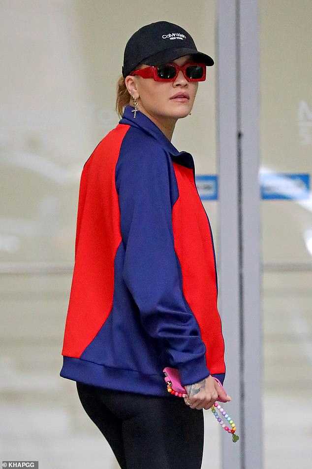 Rugged up: Later, Rita was seen heading back to her Sydney apartment, having covered up with a multicoloured sweater