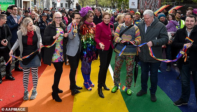 Port Phillip Council is forking out the money for a Rainbow Tick accreditation to show it is 'committed to safe, inclusive practice for LGBTQIA+ people'. Pictured: Mayor Bernadene Voss (centre) and her councillors unveil the city's rainbow road in St Kilda in 2018