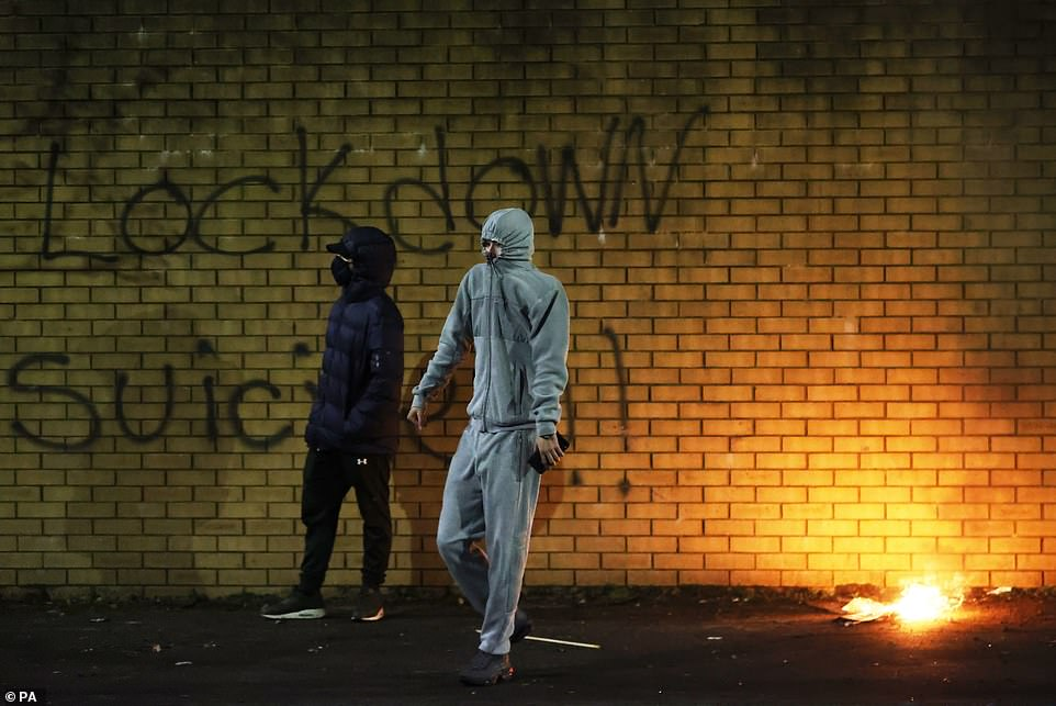 A man carrying bricks in Belfast during further unrest in Belfast on Wednesday night