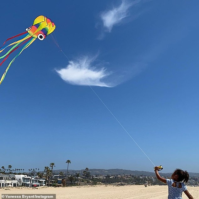 Colorful:'Let's go fly a kite,' Bryant shared in her caption, as she held a spool of string attached to a rather colorful kite