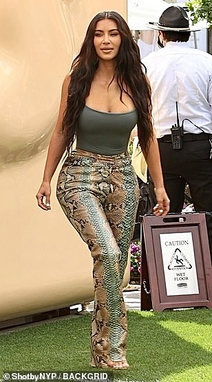 Wow! Kim teamed with a pair of striking snakeskin trousers which highlighted her peachy posterior