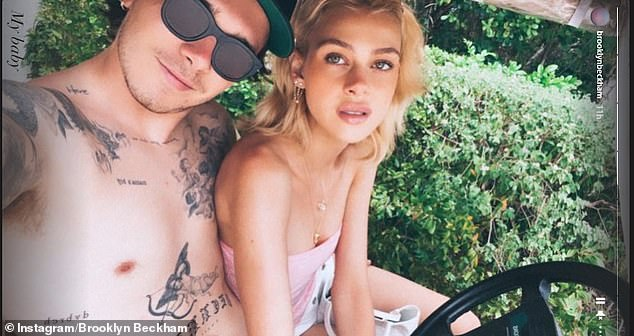 PDA:Brooklyn Beckham and Nicola Peltz looked typically loved-up as they posed for some cosy snaps in Turks and Caicos on Wednesday