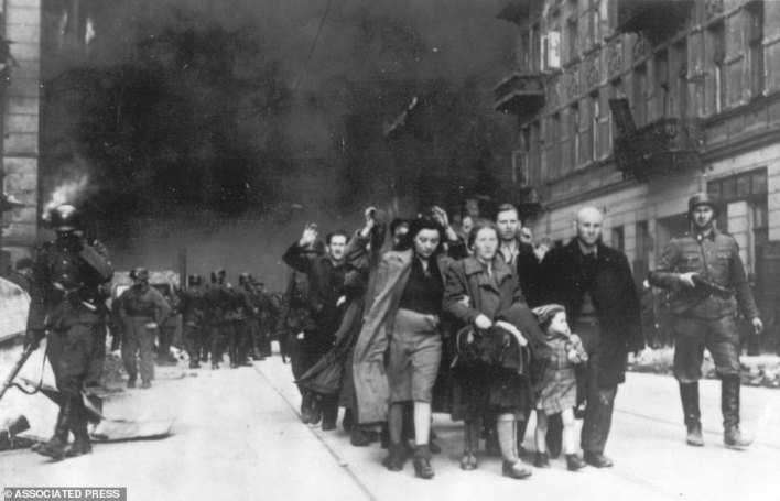 In this 1943 file photo, a group of Polish Jews are led away for deportation by German SS soldiers, in April/May 1943, during the destruction of the Warsaw Ghetto by German troops after an uprising in the Jewish quarter