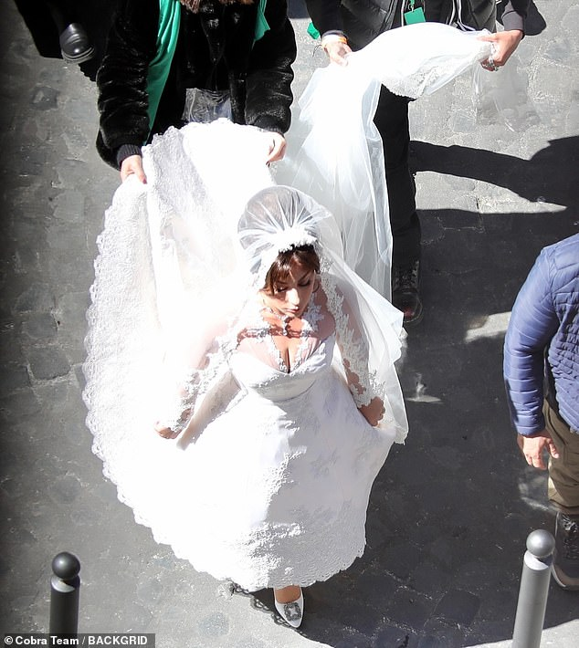 Wow: Lady Gaga wowed in a voluminous wedding dress as she filmed the House Of Gucci biopic in Milan