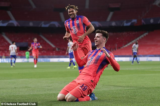 Mount celebrates his first-half strike in Seville with Chelsea team-mate Reece James